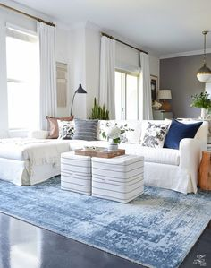 Fall Home Tour Fall Decor vintage inspired blue rug white slipcovered couch holly hock pillow covers navy velvet pillow covers rattan tray apartment living decorating an apartment-1
