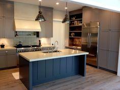 white kraftmaid kitchen cabinets midnight blue kitchen
