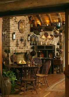 Country kitchen decor ideas. I love the wooden table and chairs.