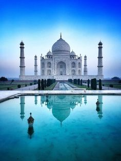 Standing majestically on the banks of the River Yamuna, India's national treasure is a symbol of love and romance. The Taj Mahal's pure white marble, exquisite ornamentation and precious gemstones make it one of the most sought-after tourist destinations Beautiful Places In The World, Places Around The World, Travel Around The World, Around The Worlds, Photo Islam, Mekka Islam, Beautiful Mosques, Destination Voyage, Tourist Places