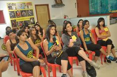 Contestants getting tips from the Golds Gym trainer for their astute fitness. Year 2011 At Gold's Gym Bandra.