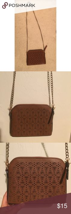 Brown crossbody bag Fake leather material with perforated designs, perfect for everyday wear and super cute! Francesca's Collections Bags Crossbody Bags