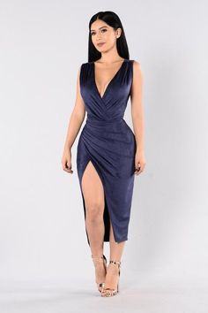 - Available in Navy - Deep V - Sleeveless - Front Slit - Ruching Detail - Faux Suede - 90% Polyester, 10% Spandex