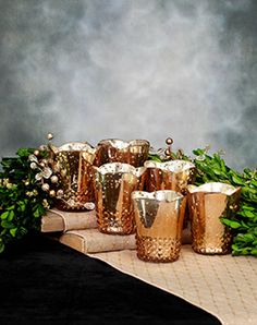 Mercury glass votive holder in rose gold -- these are a little pricey at 6/$24 but you could sell them after the wedding