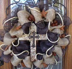 deco mesh and burlap with a large cross in the middle...beautiful!