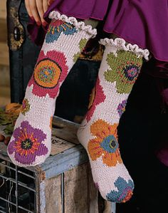 "Pattern description from Vogue Knitting, Fall 2008: ""'Keeping warm in an 1860s Ontario farmhouse can be a challenge. As a crafty gal, doing it in a stylish and knitterly way is a wonderful design challenge,' says Kandis, founder and designer of Mission Falls yarn and author of Folk Style (Interweave). 'Slipper socks and mukluks are de rigueur when tromping about our 'original' - read as draft-emanating - wood floors.' In that context and so many others, her intarsia Fall Bloom mukluks…"