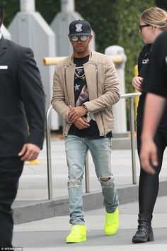 The future's bright: Lewis Hamilton was hard to miss as he arrived at the Gumball 3000 in ...