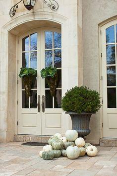 grey, cream, agey green pumpkins~boxwood topiary~love the door treatment.