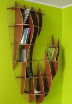 """""""Section shelves designed by Great Things to People. """"The Section Shelf belongs to the Section family. It was created by digital modeling with parametric generative algorithms capable of section volumes. This shelf has a free volume sectioned and assembled from its manufacturing plans."""""""