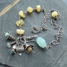Asymmetrical necklace with wire wrapped gemstone cluster