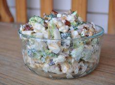 Amish Broccoli Cauliflower Salad 1 head broccoli, chopped 1 head cauliflower, chopped 1 cup mayonnaise 1 cup sour cream 1/2 cup sugar 1/2 teaspoon salt 1/2 pound bacon, fried and crumbled 1 cup shredded Cheddar cheese