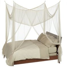 This 4-Post Bed Canopy in Ecru Color Mesh Fabric - Fits all Bed Sizes adds a romantic touch to any bedroom without seeming overly feminine. Four sheer panels of