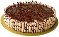 Triple Chocolate Cheesecake  A luxurious layered cheesecake bursting with three kinds of chocolate - milk, white and semisweet.Topped with ganache, cradled by a thick chocolate cookie crust and encased with chocolate wafer cookies.So creamy with a melt-in-the-mouth feel!Dimension: 10. Delivery to Paranaque, Pasay, Makati, Las Pinas, Alabang, and The Fort only.