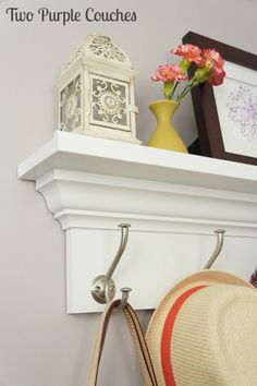 Find the tutorial for how to built this wall shelf at www.twopurplecouches.com