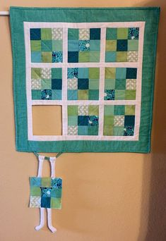 This humorous wall hanging will be custom made for you in your personal color scheme in your choice of two sizes. What a fun and decorative addition to your home, or purchase as a gift for a special friend or family member!  The sizes listed are for the body of the quilt and DO NOT INCLUDE the extra inches of the dangling renegade block. Your wall hanging will be made in several fabrics of your chosen color scheme, with the finished product on its way to you in 3-4 weeks after you have…