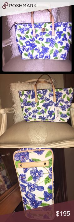 Dooney and Bourke Zip Top Shopper Tote Beautiful and practical! Carry all of your necessities in this shopper Tote. Drop a wristlet in there and have on the run freedom. Features a zippered closure. Brass hardware and feet. Leather braided pull tab. It's described as blue and white by Dooney but I believe it leans just a tad towards periwinkle. The floral print is modern yet it's an instant classic! Wear this little lovely with jeans to silk! Dooney & Bourke Bags Totes