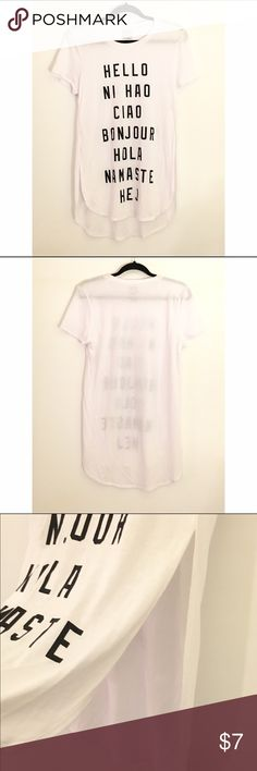 """High Slit """"Hello"""" Lingo Tee White graphic tee with """"hello"""" in many different languages. High slit sides. 65% polyester. 35% rayon. Word of Mouth Tops Tees - Short Sleeve"""