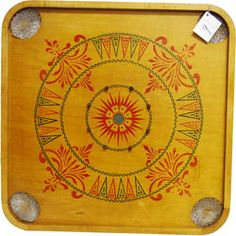 Vintage game board (1900-1914) by Carrom, won at an auction.  Will look so cool on the wall!  Double-sided.  Game is crokinole?