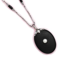 Onyx, natural pearl, diamond and platinum locket and necklace.