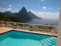 houses of the caribbean | Saint Lucia Famous Pitons, with the island of Saint Vincent's in the ...