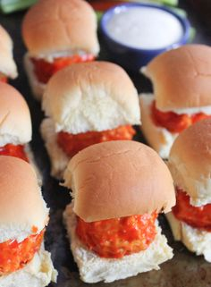 Cheesy Buffalo Chicken Meatball Sliders. These tender Buffalo chicken meatballs are filled with melted mozzarella cheese and served on warm slider buns. #ComfortFoodFeast #sliders #buffalochicken