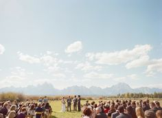 A rustic wedding at Moose Head Ranch in Jackson Hole, Wyoming with the Grand Teton Mountain Range serving as a backdrop.