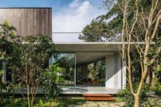 Concrete house placed close to the seashore and surrounded by a dense and rich rainforest vegetation - CAANdesign   Architecture and home design blog
