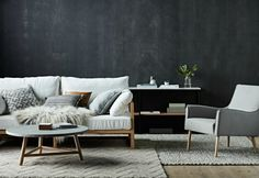 dark-scandi-living-room-with-white-sofa-and-faux-fur-throw