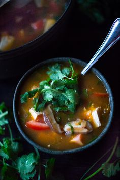 Vietnamese Hot and Sour Tamarind Soup with tomatoes, mushrooms, and tofu. Vegan and GF!