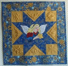Advanced Embroidery Designs. Christmas Angel Wall quilt with machine embroidery.