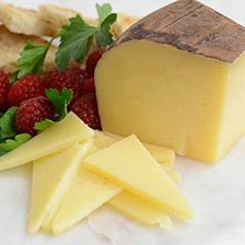 Monterey Jack, Dry - Aged 10 Months - A classic American cheese, dry-aged 10 months for a firm, straw-hued paste and sweet nutty flavor.