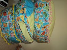 I made these a while back from a tute I found at Living With Punks. I used a mash up of fabrics I am using in the playroom and some fun trims. The kids lay all over them