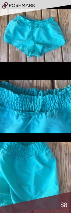 Old navy board shorts, medium, turquoise,NWOT Old navy board shorts are size medium and new without tags with no defects. Shorts are 2.5 inch inseam and have an elastic waistband with a drawstring. They are polyester quick-dry fabric and are made for the water! Old Navy Swim Coverups