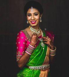 South Indian bride. Gold Indian bridal jewelry.Temple jewelry. Jhumkis. Green silk kanchipuram sari with contrast pink blouse.Braid with fresh jasmine flowers. Tamil bride. Telugu bride. Kannada bride. Hindu bride. Malayalee bride.Kerala bride.South Indian wedding.