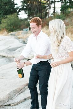 popping champagne engagement shoot - www.andreaclare.ca