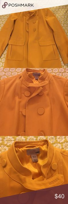 H&M yellow mid weight coat size 10 Adorable mid length mid weight yellow cotton coat with great neck and button details. Sgt. Pepper vibe, looks great over dresses in the spring and with jeans and boots in the fall. Bright sunny yellow color. Size 10. Light smudges on the bottom, but not very noticeable. Please ask questions ahead of time, no returns! H&M Jackets & Coats