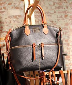 "I like this bag a lot. Last pinner said ""Dooney & Bourke"", I've never heard of this?"