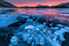 FIRE BUBBLES | Belly of Abraham, Nordegg Alberta  My last sunrise on Abraham lake, we were gifted with this fiery sunrise despite strong wind gust. It is one of the most surreal experience to walk on the lake and see thousands of bubbles in the surface. The three days in Nordegg provided us with the best conditions and light. Hope to share more from the adventure soon.