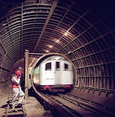 London Underground train entering tunnel during refurbishment of Angel Underground station London London Life, London Street, London Underground Train, London Underground Stations, London Transport, Public Transport, Tube Train, Train Route, London