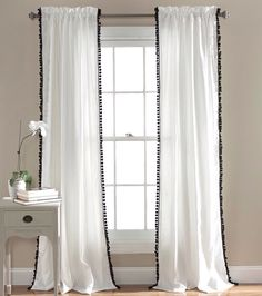 Black Pom Pom trim on white curtain panels