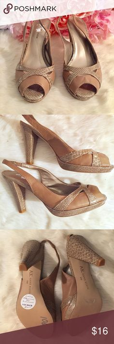 Anne Klein Peeptoe Slingback Heels Classic peeptoe slingback with a twist. Anne Klein leather and patent sling-backs. They feature a peep toe design, low platform, a high heel and an elastic back. Tan/nude. NWOT Anne Klein Shoes Heels