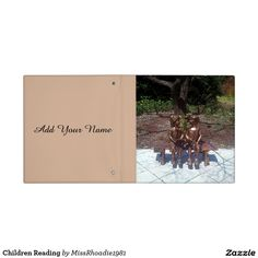 "Children Reading Vinyl Binders  Are you looking for a new binder to start the school year right? Well look no further because I have the perfect binder for you. This ""children reading"" binding features a school age boy and girl sharing a book inside of a beautiful garden. On the back is a place to customize your name. Personalize it with your text, logo, inspiration quotes, etc."