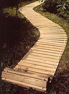 You can lay down a walkway with up to a 45 degree curve or buy an add-on 90 degree turn.  Also available are mats and decks.