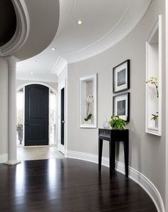 Wall color, white trim, dark floors! Paint Benjamin Moore Bennington Grey. I like dark wood floors with the black furniture and light walls