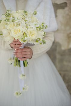 Love how the petals cascade down the ribbon of this bouquet