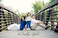 family of three on bridge.  #denverportraits, #coloradoportraitphotography, #coloradochildrensphotography, #denverfamilyphotography