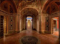 The extravagant residence Castello di Sammezzano sits on top of a hill in Tuscany, Northern Italy. Originally it was built in the Moorish style in 1605 for Ximenes d'Aragona and then re-designed between 1853 and 1889. After the war the castello was used as a luxury hotel until closure in the mid to late 1990's.