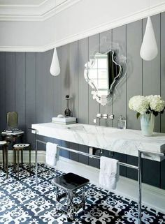 Love the repeating pattern -- mirror and flooring.