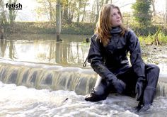 Black rubber dry suit in the water