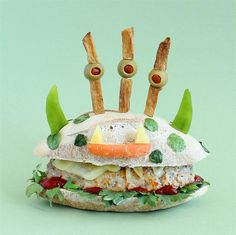 """""""Three Fry-ed Monster""""   This three-eyed monster might be what's lurking under your bed at night. If so, sleep well knowing that at least you'll have a tasty midnight snack within reach. His belly is filled with a turkey burger covered in provolone cheese. You can use any vegetables to make his facial features, but this one happens to have a baby carrot mouth with cheese fangs and green pepper horns. His spots are lettuce circles (which stick with just a tiny bit of water)."""